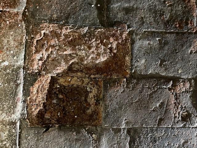 spalling brick floor